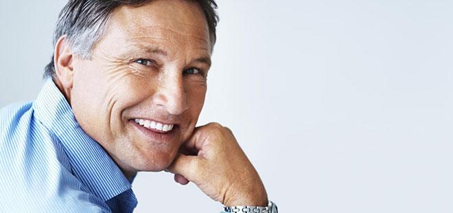 Man smiling after full mouth rehabilitation from Phoenix area Dentist Dr. Lewandowski