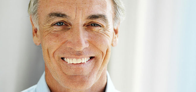 A man with dental bridges smiling after dental work from Scottsdale Dentist Dr. Lewandowski