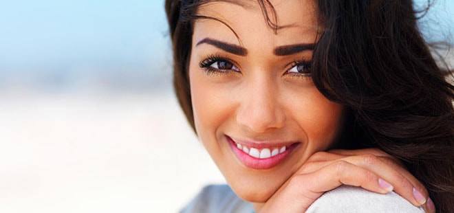 Woman smiling with metal-free fillings from Scottsdale Dentist Dr. Lewandowski