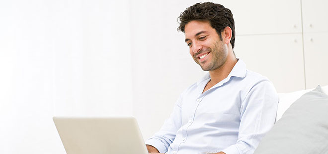 Man on computer getting looking for a patient resources