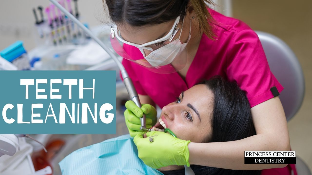 Hygienist cleans a woman's teeth