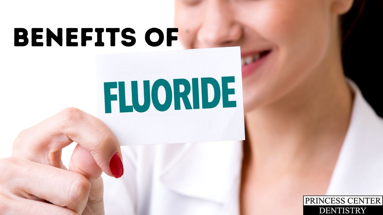 Woman holds a sign that says Fluoride